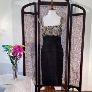 JS Collection shimmering black sleeveless dress.